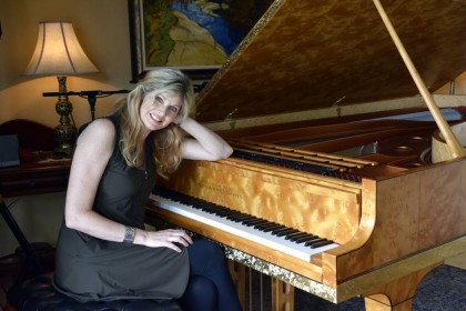 Busy calendar: Fiona Joy with her much-loved Stuart & Sons concert grand piano.